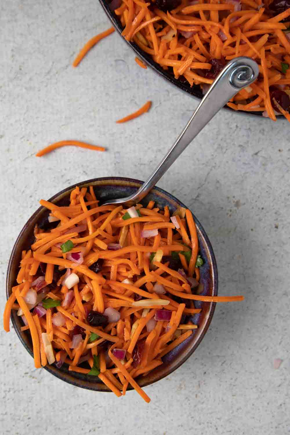 bowl of shredded carrot salad and fork